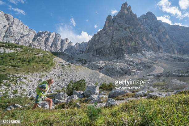 Hiking in Summer, female in the Dolomites, Italy