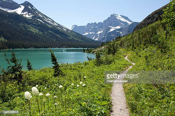Hiking trail and boat in Lake Josephine Glacier National Park