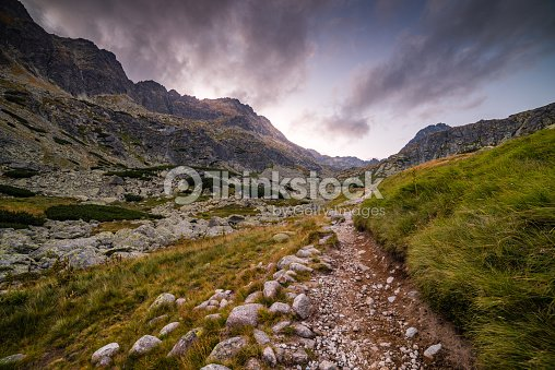 hiking trail in the mountains at sunset ストックフォト thinkstock