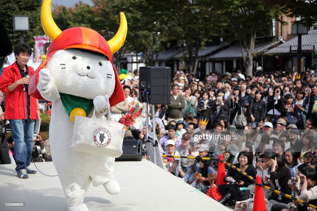 Hikonyan, the mascot of Hikone Castle 400th Anniversary, who sparked the Yuru Chara boom in Japan, is seen on stage during the 'Yuru Chara Festival in Hikone' at Yumekyobashi Castle Road on October 23, 2010 in Hikone, Shiga, Japan. Yuru Chara, abbreviation of 'Yurui (unserious or relaxing)' and 'Character', are mascots of local governments, companies etc. The festival attracts 35,000 Yuru Chara fans.
