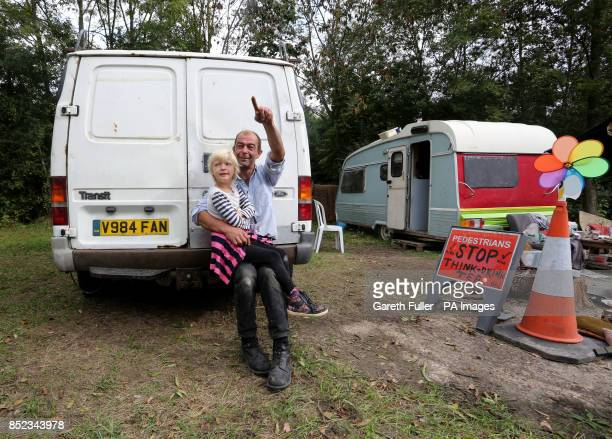 Hilaire with his daughter Mabel sit on the back of his van after 10 weeks outside the Caudrilla exploratory drilling site in Balcombe West Sussex as...