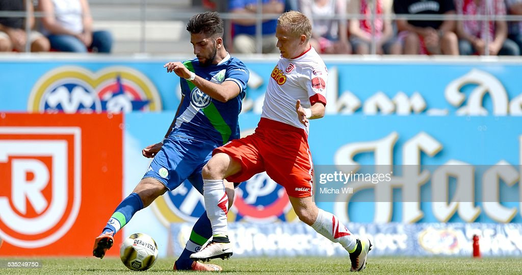 Hilal El-Helwe (L) of Wolfsburg is challenged by Alexander Nandzik of Regensburg during the Third League play off second leg match between Jahn Regensburg and VfL Wolfsburg II at Continental Arena on May 29, 2016 in Regensburg, Germany.