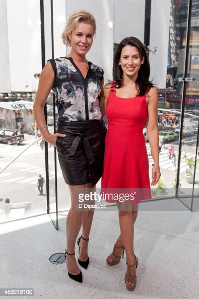 Hilaria Baldwin interviews Rebecca Romijn during her visit to 'Extra' at their New York studios at HM in Times Square on August 5 2014 in New York...