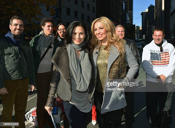 Hilaria Baldwin interviews singer Thalia during her visit to 'Extra' in Times Square on November 4 2013 in New York City