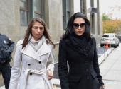 Hilaria Baldwin wife of actor Alec Baldwin arrives at Manhattan Criminal Court to testify against Canadian actress Genevieve Sabourin the accused...