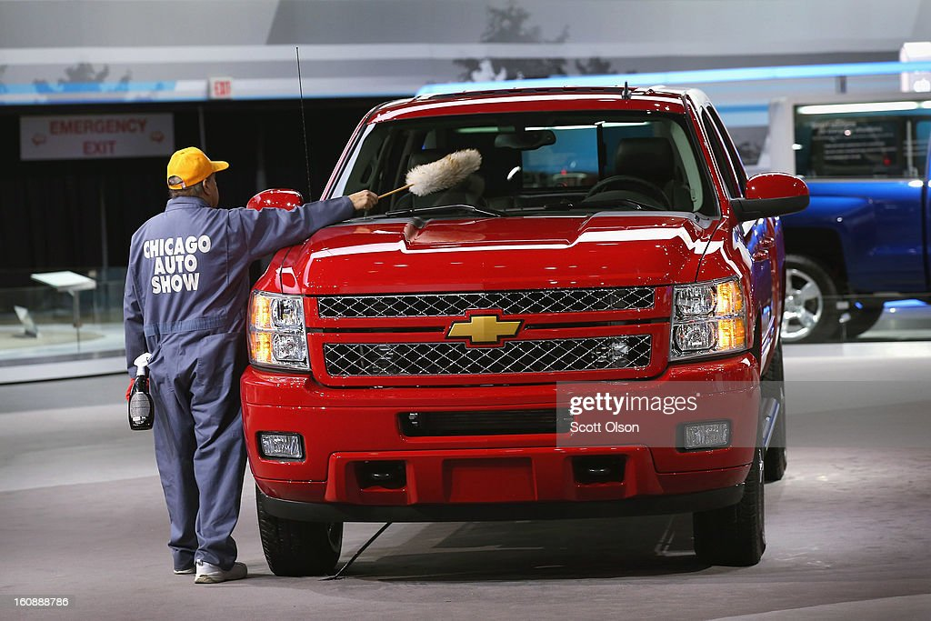 Hilario Reyes details a Chevrolet Silverado LTZ at the Chicago Auto Show on February 7, 2013 in Chicago, Illinois. The Chicago Auto Show, one of the oldest and largest in the country, will be open to the public February 9-18.