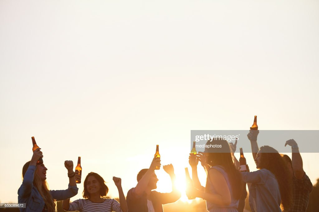 Hilarious party at sunset : Bildbanksbilder