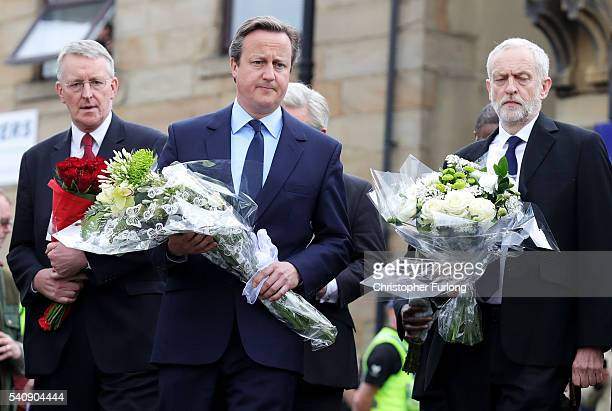 Hilary Benn MP for Leeds Central Prime Minister David Cameron and Labour Leader Jeremy Corbyn arrive to pay their respects near to the scene of the...