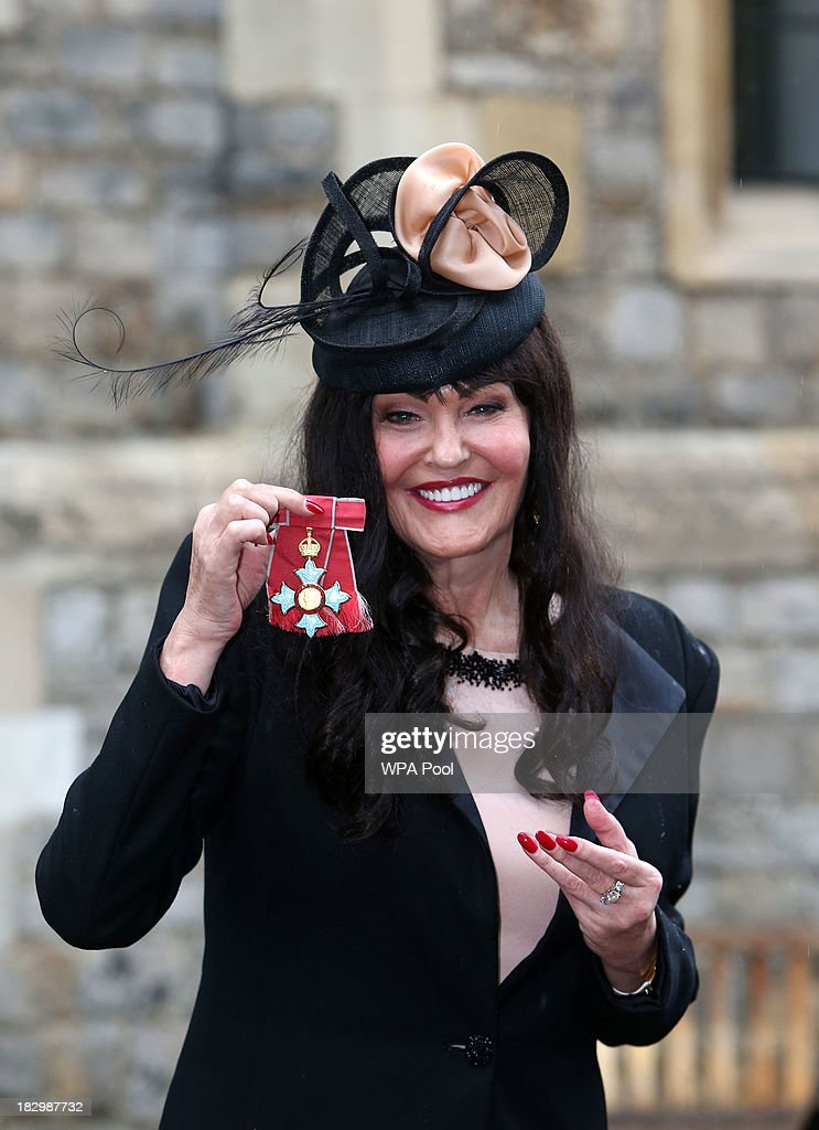 Hilary Devey received a CBE for Transport Industry and Charities at Windsor Castle on October 3, 2013 in Widsor, England.