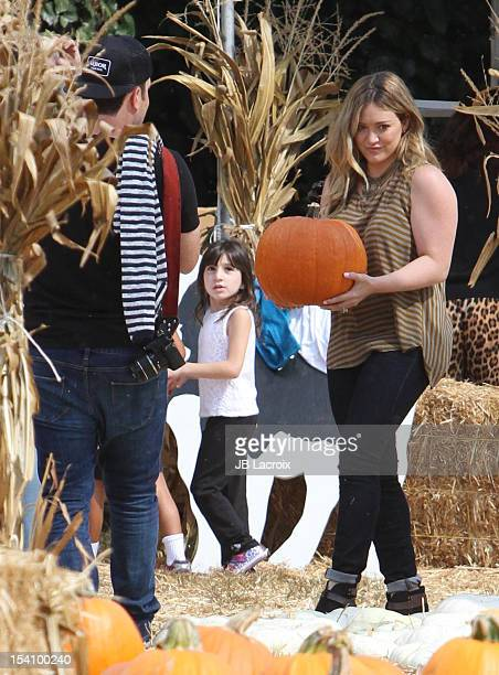 Hilary Duff and Mike Comrie are seen at the Mr Bones pumpkin patch on October 13 2012 in Los Angeles California