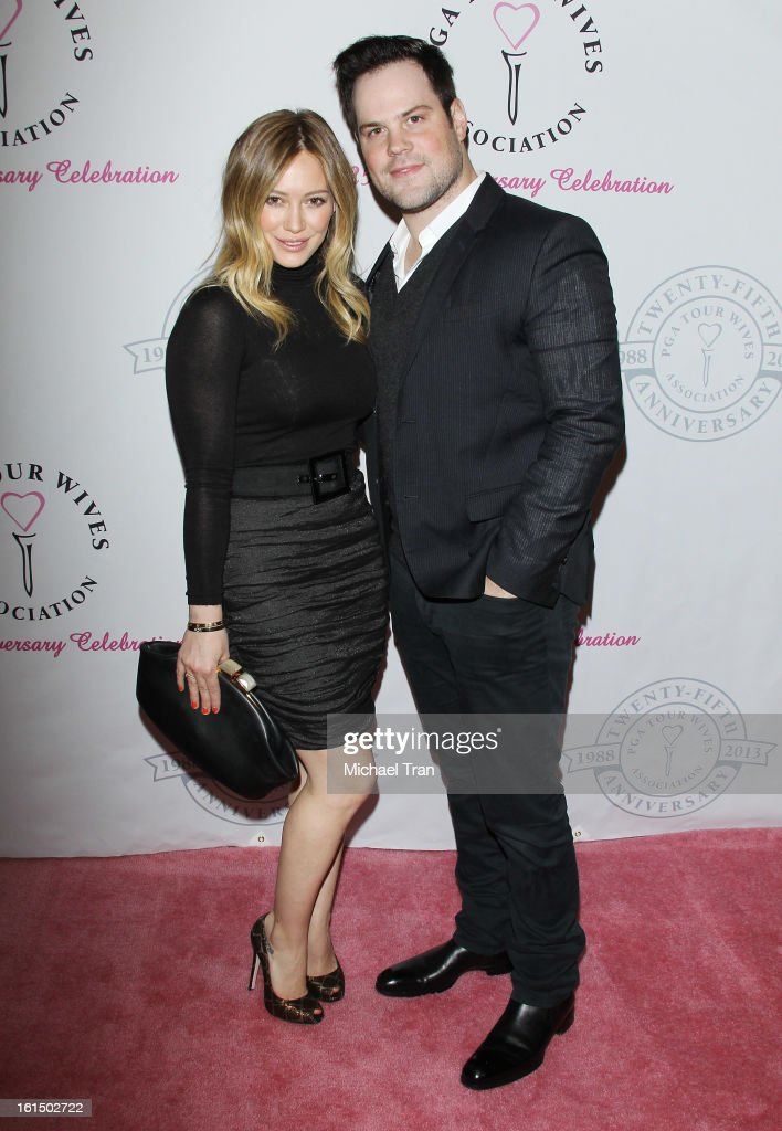 <a gi-track='captionPersonalityLinkClicked' href=/galleries/search?phrase=Hilary+Duff&family=editorial&specificpeople=201586 ng-click='$event.stopPropagation()'>Hilary Duff</a> (L) and <a gi-track='captionPersonalityLinkClicked' href=/galleries/search?phrase=Mike+Comrie&family=editorial&specificpeople=201531 ng-click='$event.stopPropagation()'>Mike Comrie</a> arrive at the PGA TOUR Wives Association celebrates its 25th Anniversary held at Fairmont Miramar Hotel on February 11, 2013 in Santa Monica, California.