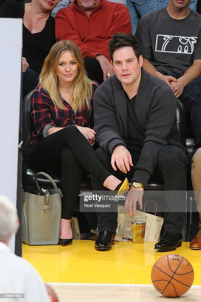 Hilary Duff (L) and Mike Comrie attend a basketball game between the Miami Heat and the Los Angeles Lakers at Staples Center on January 17, 2013 in Los Angeles, California.