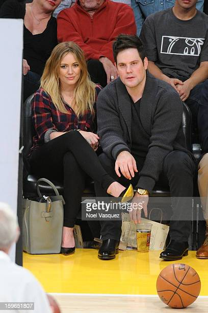 Hilary Duff and Mike Comrie attend a basketball game between the Miami Heat and the Los Angeles Lakers at Staples Center on January 17 2013 in Los...