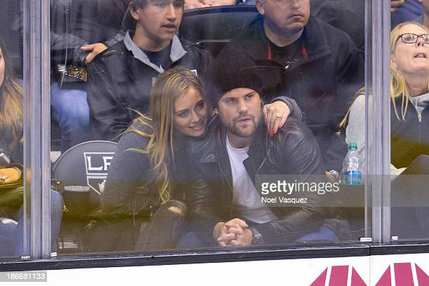 Hilary Duff and Mike Comrie attend a hockey game between the Nashville Predators and the Los Angeles Kings at Staples Center on November 2 2013 in...