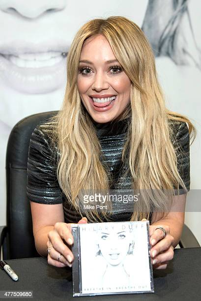 Hilary Duff attends her 'Breathe In Breathe Out' CD signing event at the Smith Haven Mall on June 17 2015 in Lake Grove New York