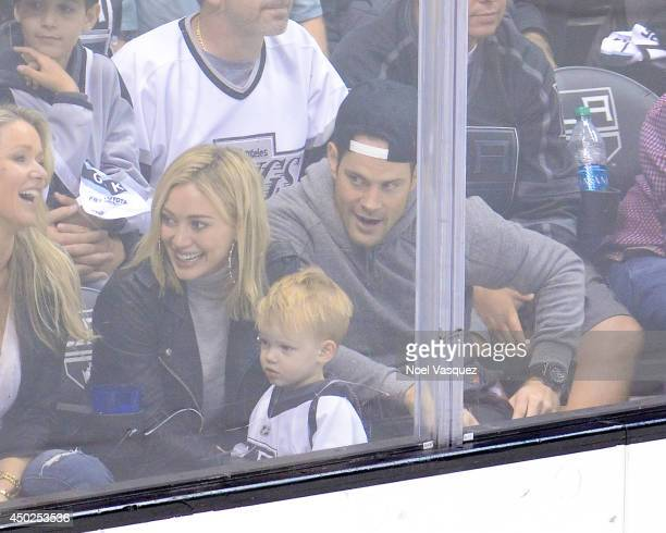 Hilary Duff Luca Comrie and Mike Comrie attend a hockey game between the New York Rangers and the Los Angeles Kings in Game Two of the 2014 NHL...