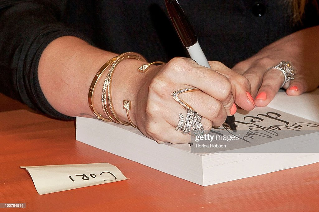 Hilary Duff (fashion detail) signs copies of her new book 'True' at Mrs. Nelson's Toy & Book Shop on April 16, 2013 in La Verne, California.