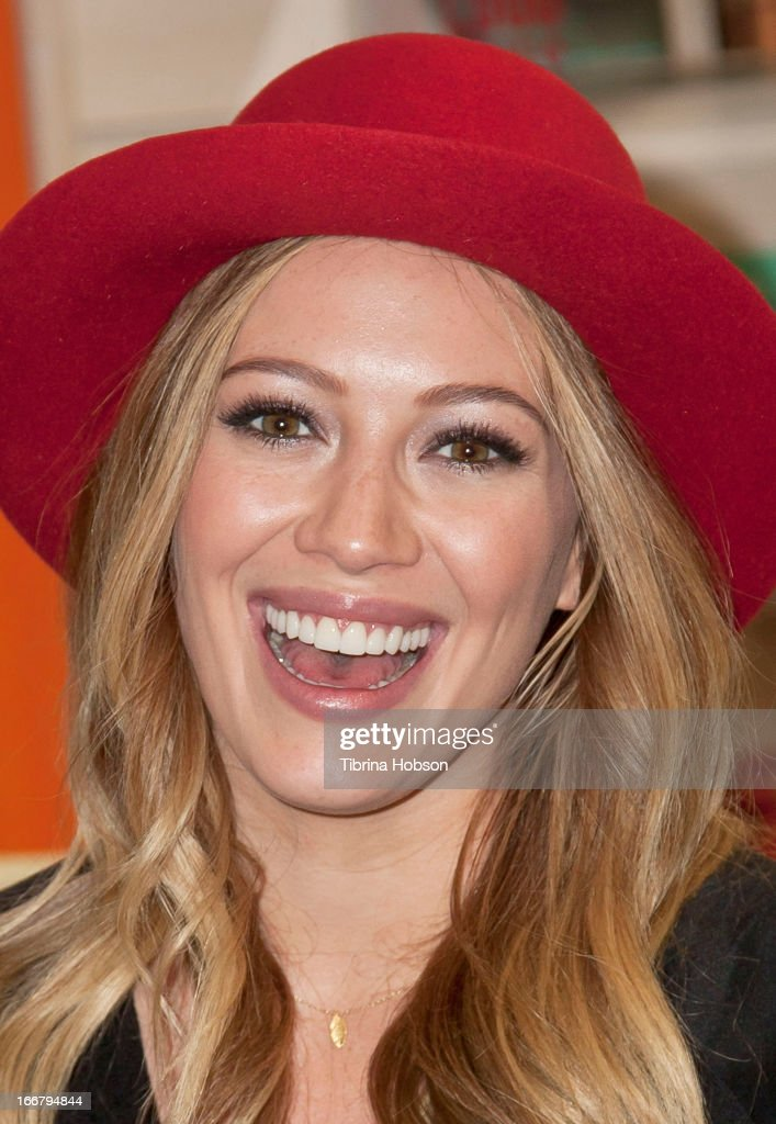 <a gi-track='captionPersonalityLinkClicked' href=/galleries/search?phrase=Hilary+Duff&family=editorial&specificpeople=201586 ng-click='$event.stopPropagation()'>Hilary Duff</a> signs copies of her new book 'True' at Mrs. Nelson's Toy & Book Shop on April 16, 2013 in La Verne, California.