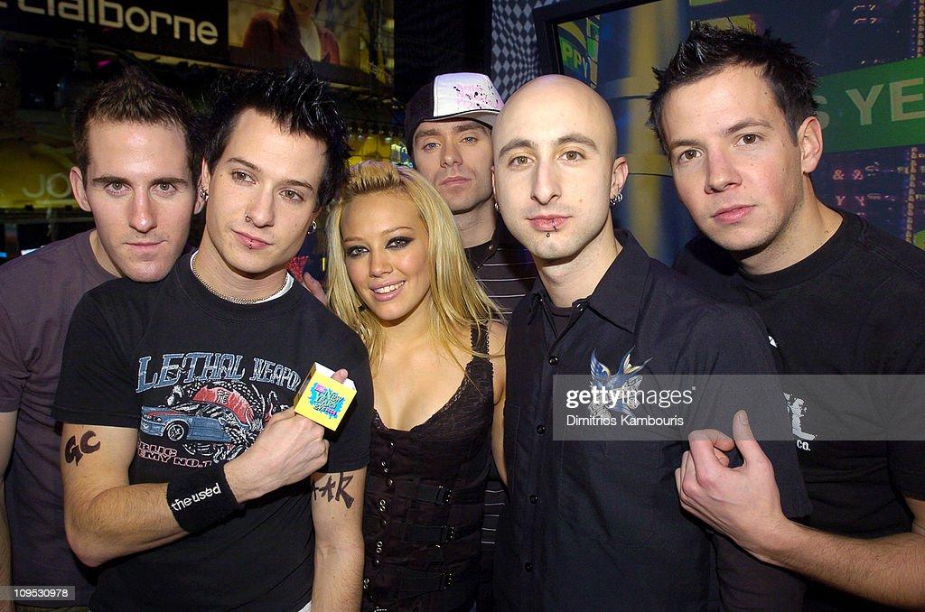 Hilary Duff with Chuck Comeau David Desrosiers Sebastien Lefebvre Jeff Stinco and Pierre Bouvier of Simple Plan