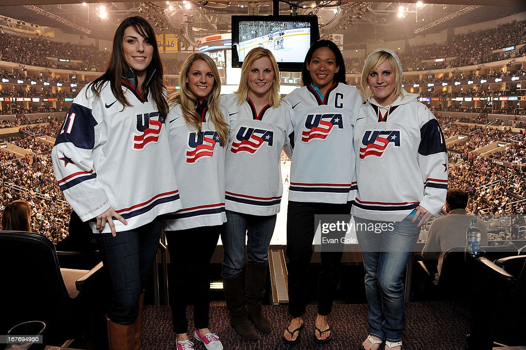 Hilary Knight, Amanda Kessel, Jocelyne Lamoureux, Julie Chu and Monique Lamoureux of the USA Women's Hockey Team pose for a picture during the game between the Los Angeles Kings and the San Jose Sharks at Staples Center on April 27, 2013 in Los Angeles, California.