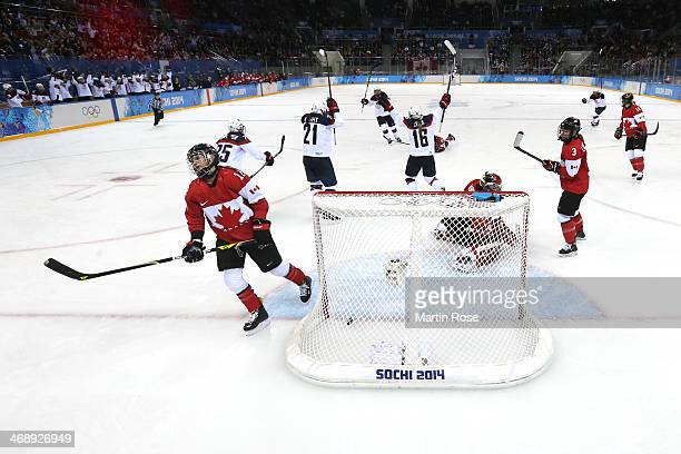 Hilary Knight and Kelli Stack of the United States look on after Knight scores against Charline Labonte of Canada in the second period during the...