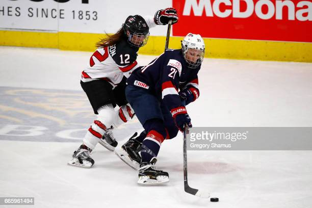 Hilary Knight of the United States battles for the puck with Meaghan Mikkelson of Canada during the second period in the gold medal game at the 2017...