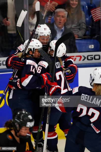 Hilary Knight of the United States celebrates her firstperiod goal with Brianna Decker and Kendall Coyne while playing Germany during a semifinal...