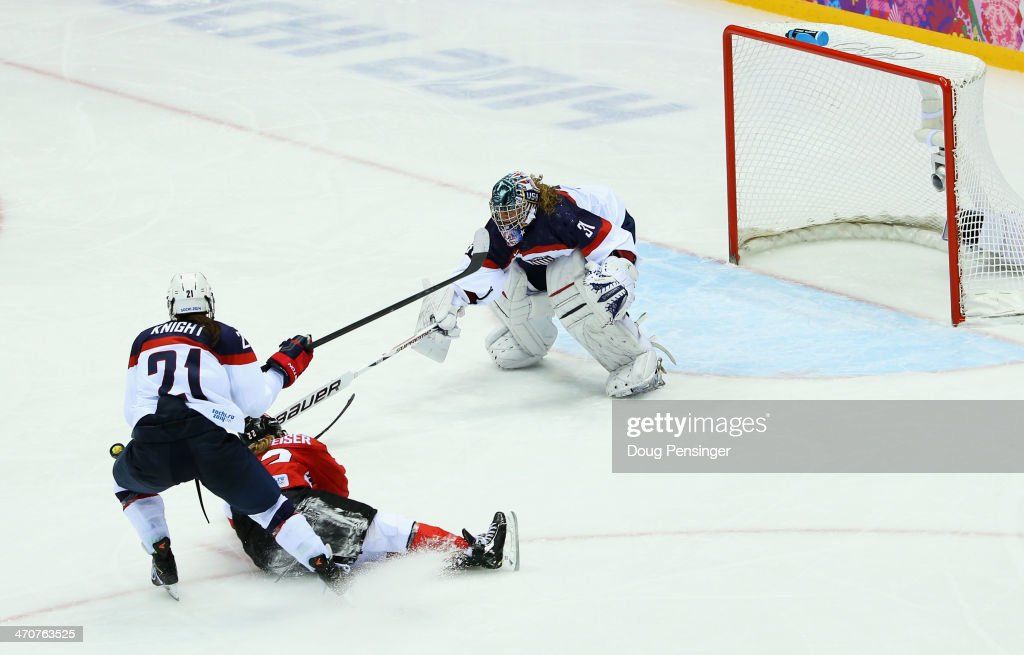 Hilary Knight #21 of the United States cross-checks <a gi-track='captionPersonalityLinkClicked' href=/galleries/search?phrase=Hayley+Wickenheiser&family=editorial&specificpeople=722145 ng-click='$event.stopPropagation()'>Hayley Wickenheiser</a> #22 of Canada during the Ice Hockey Women's Gold Medal Game on day 13 of the Sochi 2014 Winter Olympics at Bolshoy Ice Dome on February 20, 2014 in Sochi, Russia.