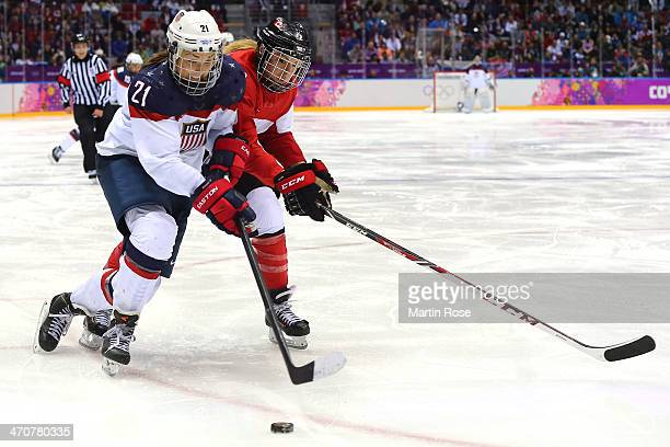 Hilary Knight of United States and Meghan AgostaMarciano of Canada in action during the Ice Hockey Women's Gold Medal Game on day 13 of the Sochi...