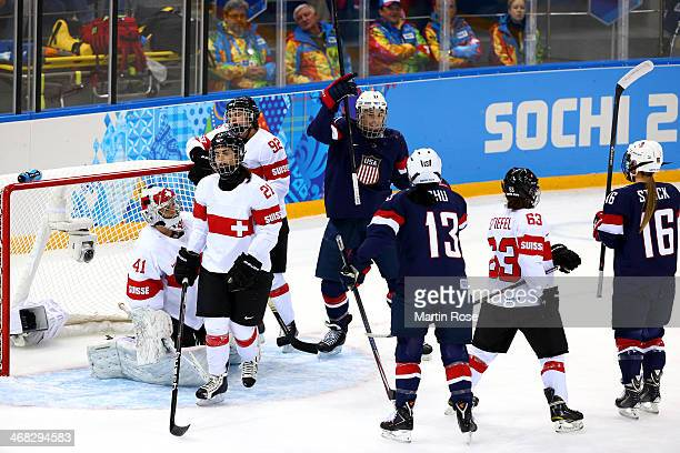 Hilary Knight of United States celebrates after scoring ehr team's fourth goal during the first period in the Women's Ice Hockey Preliminary Round...