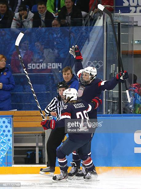 Hilary Knight of United States celebrates with her teammate Amanda Kessel after scoring a goal on Noora Raty of Finland in the first period to during...
