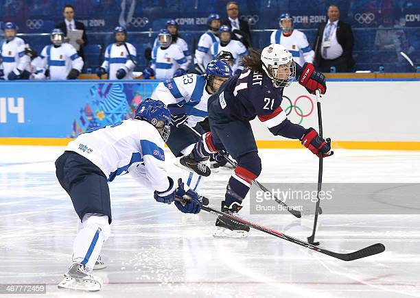 Hilary Knight of United States scores a first period goal against Finland during the Women's Ice Hockey Preliminary Round Group A Game on day 1 of...