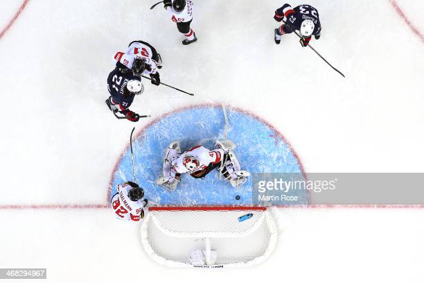Hilary Knight of United States scores her team's fourth goal in the first period during the Women's Ice Hockey Preliminary Round Group A game against...