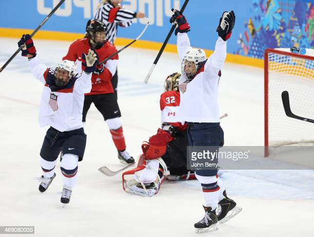 Hilary Knight of USA celebrates her goal with Kelli Stack during the Women's Ice Hockey Preliminary Round Group A game between USA and Canada on day...