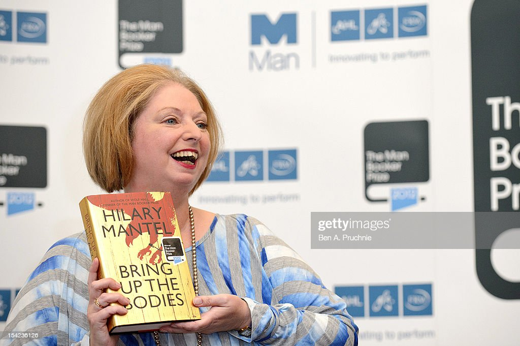 <a gi-track='captionPersonalityLinkClicked' href=/galleries/search?phrase=Hilary+Mantel&family=editorial&specificpeople=590045 ng-click='$event.stopPropagation()'>Hilary Mantel</a> wins the Man Booker Prize 2012 with her book 'Bring Up The Bodies' at The Guildhall on October 16, 2012 in London, England.