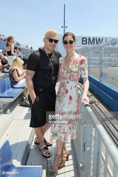 Hilary Rhoda and Sean Avery pose for a photo as GH Mumm Champagne celebrates Formula E with Mumm Grand Cordon at the inaugural ePrix Race on July 16...