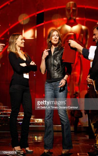 APPLY*** Hilary Swank and Kathryn Bigelow get direction before they rehearse announcing the winner of the Directing award on stage in the Kodak...