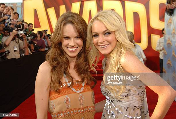 Hilary Swank and Lindsay Lohan during 2005 MTV Movie Awards Red Carpet at Shrine Auditorium in Los Angeles California United States