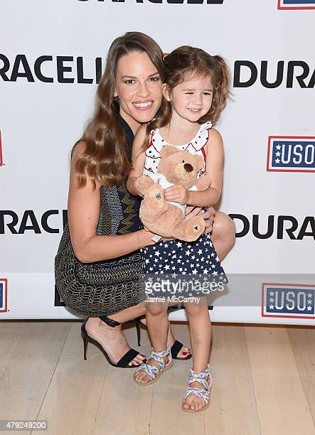 Hilary Swank and Mackenzie Nilson daughter of a military family attend the USO's 'Comfort Crew For Military Kids' Event at Times Center on July 2...