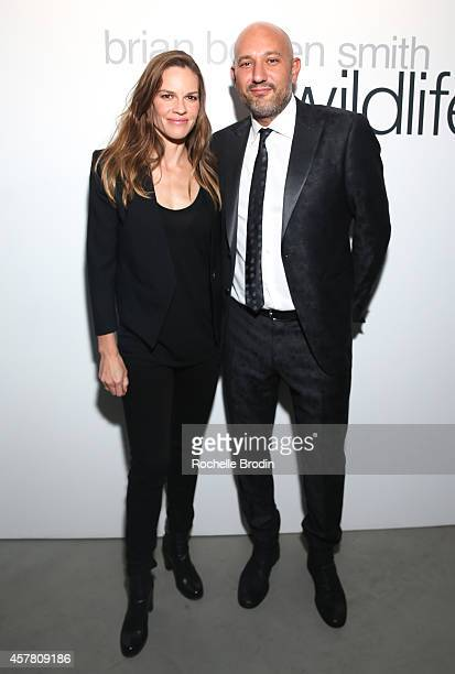 Hilary Swank and Steph Sebbag attend Brian Bowen Smith's WILDLIFE Show Hosted By Casamigos Tequila at De Re Gallery on October 23 2014 in West...