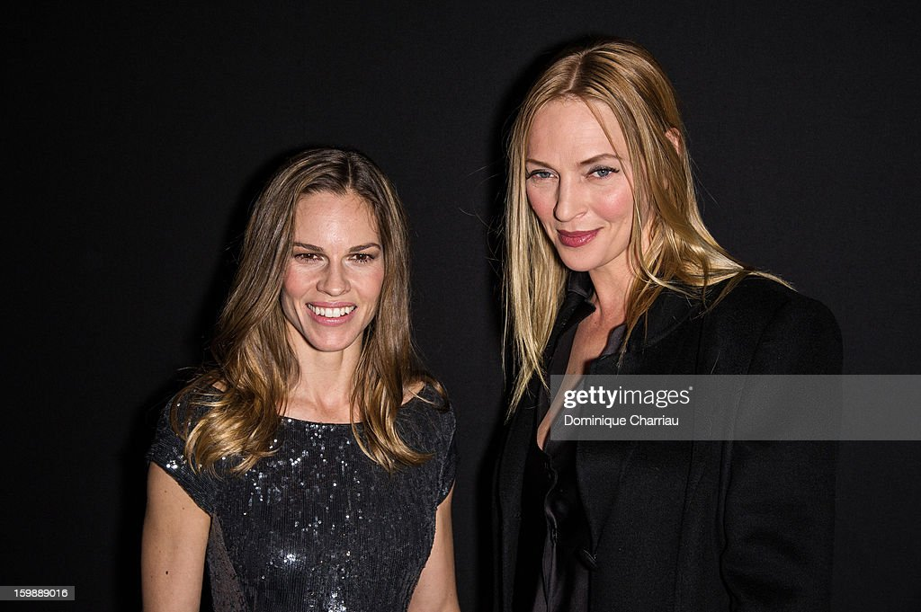 <a gi-track='captionPersonalityLinkClicked' href=/galleries/search?phrase=Hilary+Swank&family=editorial&specificpeople=201692 ng-click='$event.stopPropagation()'>Hilary Swank</a> and <a gi-track='captionPersonalityLinkClicked' href=/galleries/search?phrase=Uma+Thurman&family=editorial&specificpeople=171973 ng-click='$event.stopPropagation()'>Uma Thurman</a> attend the Giorgio Armani Prive Spring/Summer 2013 Haute-Couture show as part of Paris Fashion Week at Theatre National de Chaillot on January 22, 2013 in Paris, France.