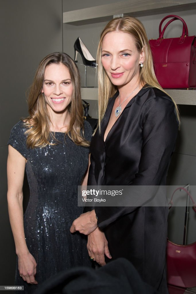 <a gi-track='captionPersonalityLinkClicked' href=/galleries/search?phrase=Hilary+Swank&family=editorial&specificpeople=201692 ng-click='$event.stopPropagation()'>Hilary Swank</a> and <a gi-track='captionPersonalityLinkClicked' href=/galleries/search?phrase=Uma+Thurman&family=editorial&specificpeople=171973 ng-click='$event.stopPropagation()'>Uma Thurman</a> attends the Giorgio Armani Paris avenue Montaigne boutique opening on January 22, 2013 in Paris, France.