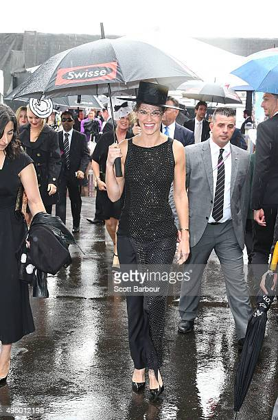 Hilary Swank arrives carrying an umbrella at the Swisse Marquee on Derby Day at Flemington Racecourse on October 31 2015 in Melbourne Australia