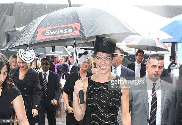 Hilary Swank arrives carrying an umbrella in the rain at the Swisse Marquee on Derby Day at Flemington Racecourse on October 31 2015 in Melbourne...