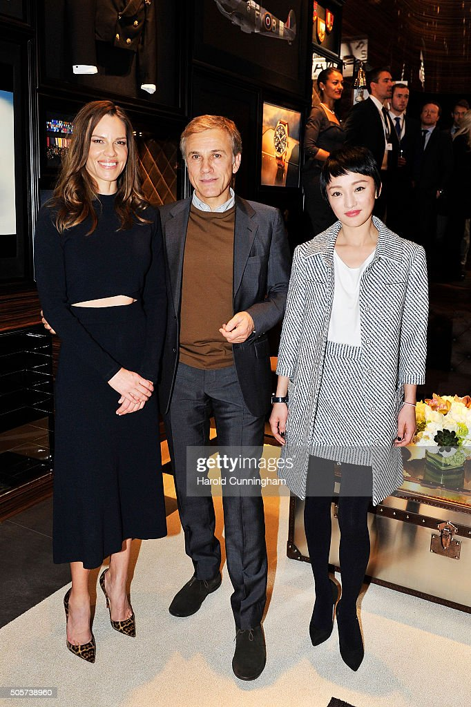 Hilary Swank, Christoph Waltz and Zhou Xun visit the IWC booth during the launch of the Pilot's Watches Novelties from the Swiss luxury watch manufacturer IWC Schaffhausen at the Salon International de la Haute Horlogerie (SIHH) 2016 on January 19, 2016 in Geneva, Switzerland.