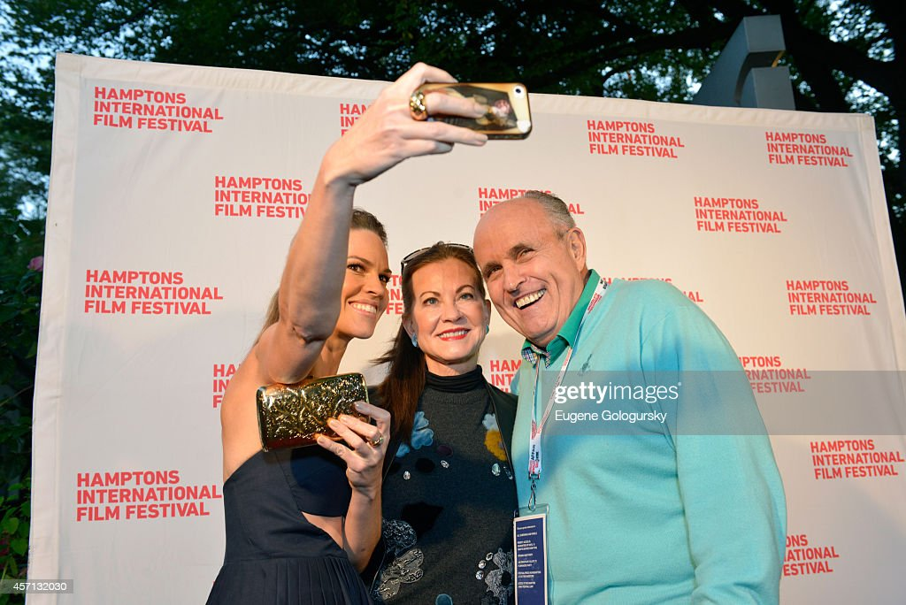 Hilary Swank Judith Nathan and Rudy Giuliani attend 'The Homesman' premiere during the 2014 Hamptons International Film Festival on October 12 2014...