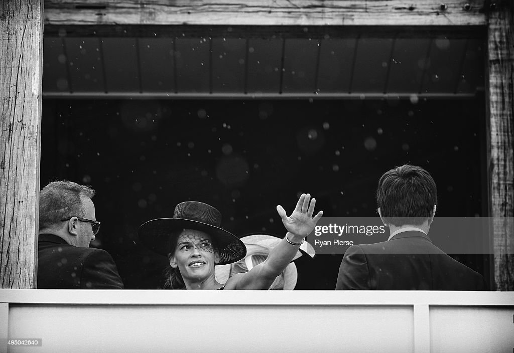 Hilary Swank looks on in the rain at the Swisse Marquee on Derby Day at Flemington Racecourse on October 31 2015 in Melbourne Australia