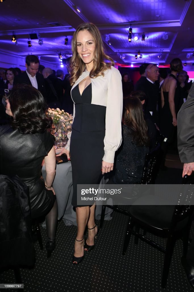 <a gi-track='captionPersonalityLinkClicked' href=/galleries/search?phrase=Hilary+Swank&family=editorial&specificpeople=201692 ng-click='$event.stopPropagation()'>Hilary Swank</a> poses at the Gerard Darel table for the Sidaction Gala Dinner 2013 at Pavillon d'Armenonville on January 24, 2013 in Paris, France.