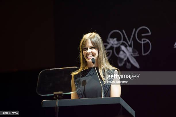 Hilary Swank speaks on stage during the inaugural amfAR India event at the Taj Mahal Palace Mumbai on November 17 2013 in Mumbai India
