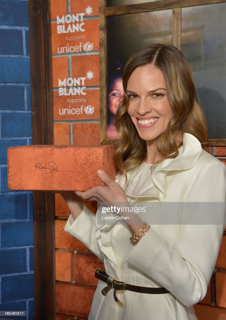 <a gi-track='captionPersonalityLinkClicked' href=/galleries/search?phrase=Hilary+Swank&family=editorial&specificpeople=201692 ng-click='$event.stopPropagation()'>Hilary Swank</a> wearing Montblanc Collection Princesse Grace de Monaco in Red Gold and diamonds attends a Pre-Oscar charity brunch hosted by Montblanc and UNICEF to celebrate the launch of their new 'Signature For Good 2013' Initiative with special guest <a gi-track='captionPersonalityLinkClicked' href=/galleries/search?phrase=Hilary+Swank&family=editorial&specificpeople=201692 ng-click='$event.stopPropagation()'>Hilary Swank</a> at Hotel Bel-Air on February 23, 2013 in Los Angeles, California.